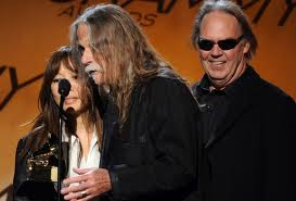 Gary Burden, Jenice Heo, and Neil Young receive their 2010 Grammy Award